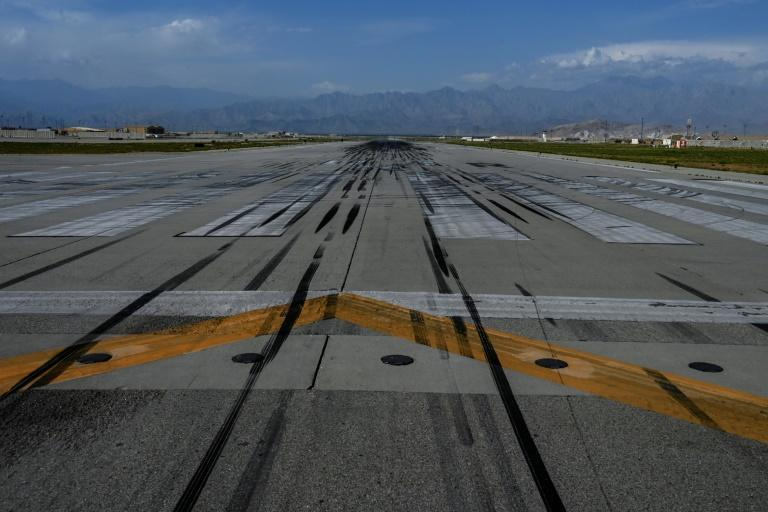 The runway at Bagram Air Base, from which US forces used to provide vital air cover to Afghan troops fighting the Taliban, is seen on July 5, 2021, after Washington handed the base over to Kabul