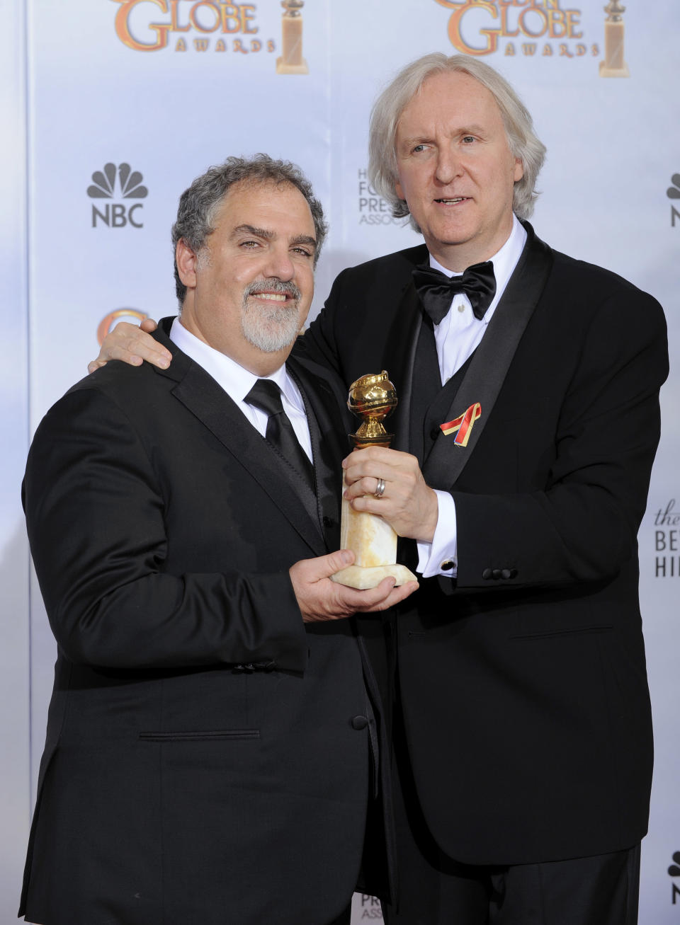 """Producer Jon Landau, left, and director James Cameron pose with the award for best motion picture drama for """"Avatar"""" backstage at the 67th Annual Golden Globe Awards on Sunday, Jan. 17, 2010, in Beverly Hills, Calif. (AP Photo/Mark J. Terrill)"""