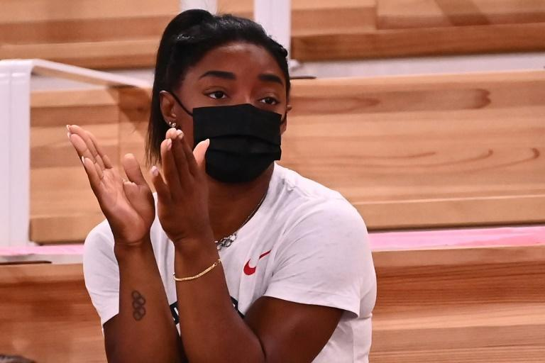 Reluctant bystander Simone Biles