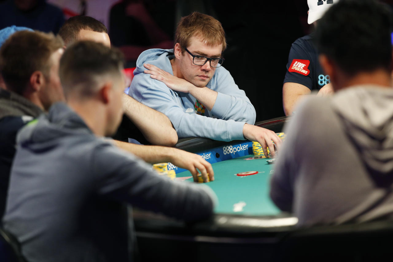 Michael Dyer, center, competes at the final table during the World Series of Poker main event Thursday, July 12, 2018, in Las Vegas. (AP Photo/John Locher)