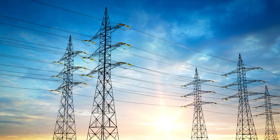 Electrical poles of high voltage in blue sky