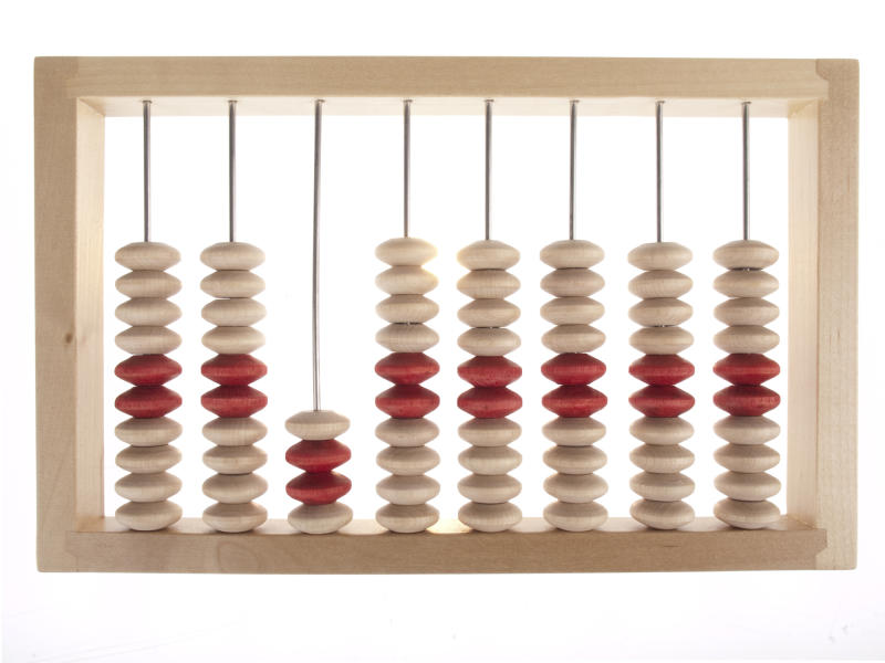 An abacus with beige and red beads.