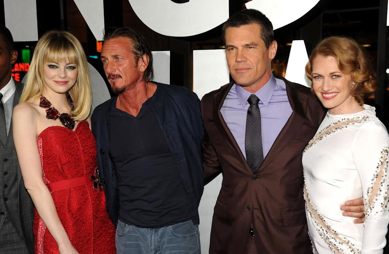 """HOLLYWOOD, CA - JANUARY 07:  (L-R) Actors Emma Stone, Sean Penn, Josh Brolin and Mireille Enos arrive at Warner Bros. Pictures' """"Gangster Squad"""" premiere at Grauman's Chinese Theatre on January 7, 2013 in Hollywood, California.  (Photo by Kevin Winter/Getty Images)"""
