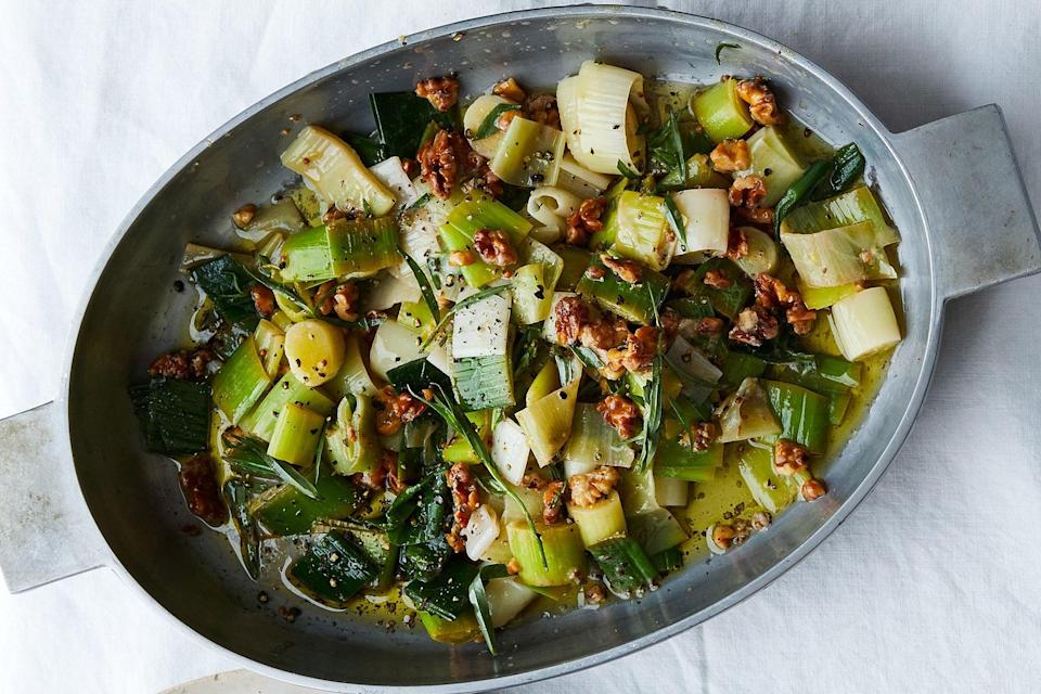 """If you want to show off that you know your way around a leek, make this riff on a classic leeks in vinaigrette. Cooking the leeks in boiling salted water, like pasta, gets you where you want to go: to melty leek town. <a href=""""https://www.epicurious.com/recipes/food/views/leeks-in-vinaigrette-with-walnuts-and-tarragon?mbid=synd_yahoo_rss"""" rel=""""nofollow noopener"""" target=""""_blank"""" data-ylk=""""slk:See recipe."""" class=""""link rapid-noclick-resp"""">See recipe.</a>"""