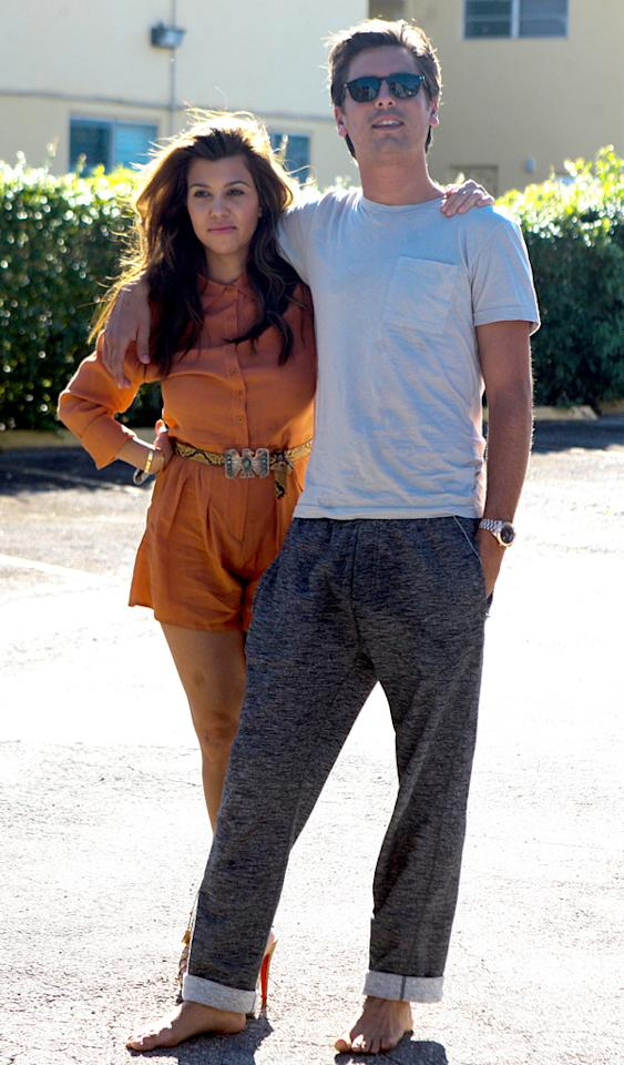 Kourtney Kardashian and Scott Disick have a great time in a Miami parking lot, as Scott reveals a new surprise for Kourtney. The surprise just happened to be a new Ferrari, out of the box.  Pictured: Kourtney Kardashian and Scott Disick  Ref: SPL447628  291012  Picture by: Juan Garces/Chris Garces/jessiev/ Splash News   Splash News and Pictures Los Angeles:310-821-2666 New York:212-619-2666 London:870-934-2666 photodesk@splashnews.com