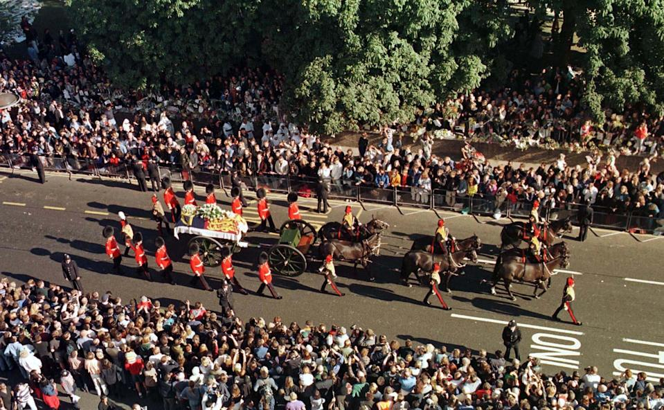 Diana's funeral procession in front of crowdsBarry Batchelor/Shutterstock