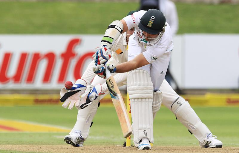 South Africa's batsman Dean Elgar, front, plays a ball as Australia's wicketkeeper Brad Haddin, rear, watches on the first day of their 2nd cricket test match at St George's Park in Port Elizabeth, South Africa, Thursday, Feb. 20, 2014. (AP Photo/ Themba Hadebe)