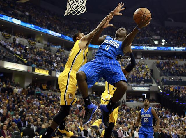 Orlando Magic guard Victor Oladipo (5) puts up a shot while defended by Indiana Pacers guard George Hill in the first half of an NBA basketball game in Indianapolis, Tuesday, Oct. 29, 2013. (AP Photo/R Brent Smith)