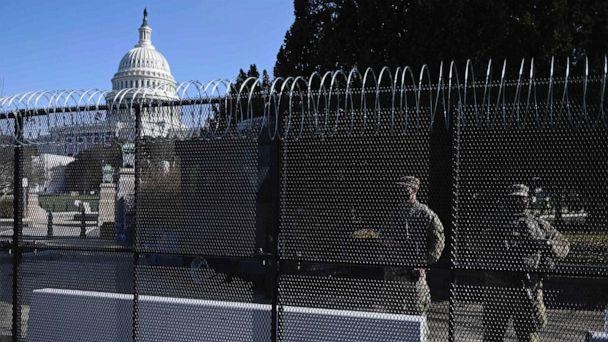 PHOTO: Barbed wire is installed on the top of a security fence surrounding the U.S. Capitol in Washington, D.C., Jan. 14, 2021, ahead of the presidential inauguration of Joe Biden on Jan. 20. (Andrew Caballero-Reynolds/AFP via Getty Images)