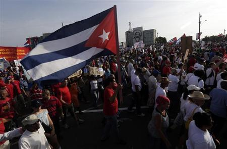 A man waves a Cuban flag in Havana's Revolution Square during the May Day parade