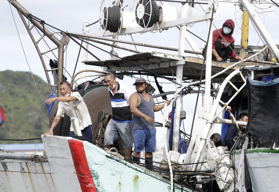 Fishermen fasten a boat to take shelter as Typhoon Chanthu approaches to Taiwan in Keelung, New Taipei City, Taiwan, Saturday, Sept. 11, 2021. Taiwan's weather bureau warned of high winds and heavy rain as Typhoon Chanthu roared toward the island Saturday and said the storm's center was likely to pass its east coast instead of hitting land. (AP Photo/Chiang Ying-ying)