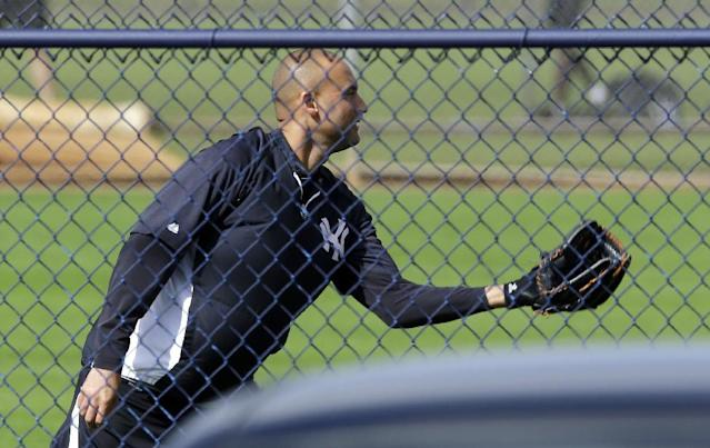 New York Yankees shortstop Derek Jeter plays catch during a workout at the baseball team's minor league facility Thursday, Feb. 13, 2014, in Tampa, Fla. Jeter announced he will be retiring at the end of the 2014 season. (AP Photo/Chris O'Meara)