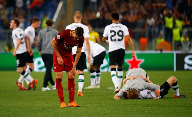 Soccer Football - Champions League Semi Final Second Leg - AS Roma v Liverpool - Stadio Olimpico, Rome, Italy - May 2, 2018 Roma's Patrik Schick looks dejected after the match as Liverpool players celebrate REUTERS/Tony Gentile