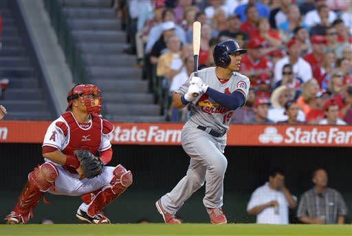 St. Louis Cardinals' Jon Jay watches his two-run home run in front of Los Angeles Angels catcher Hank Conger during the second inning of a baseball game, Wednesday, July 3, 2013, in Anaheim, Calif. (AP Photo/Mark J. Terrill)