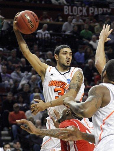 Louisville guard Peyton Siva looks to pass during the first half of their NCAA tournament third-round college basketball game against Louisville in Portland, Ore., Saturday, March 17, 2012. (AP Photo/Don Ryan)