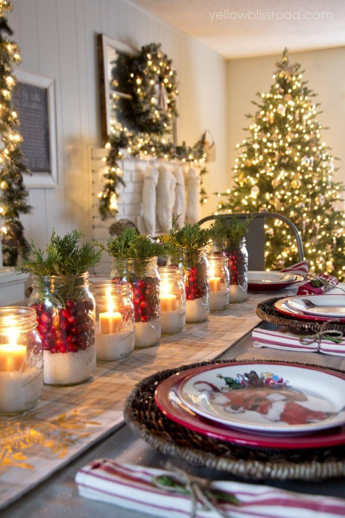 """<p>Light up your holiday table with this stunning centerpiece that alternates candles in Mason jars with jars filled with cranberries.</p><p><strong>Get the tutorial at <a href=""""https://www.yellowblissroad.com/christmas-home-tour-2014/"""" rel=""""nofollow noopener"""" target=""""_blank"""" data-ylk=""""slk:Yellow Bliss Road"""" class=""""link rapid-noclick-resp"""">Yellow Bliss Road</a>.</strong></p><p><strong><a class=""""link rapid-noclick-resp"""" href=""""https://www.amazon.com/Yummi-Unscented-Sandstone-Votive-Candles/dp/B00AY6ZWHG/ref=sr_1_14_sspa?tag=syn-yahoo-20&ascsubtag=%5Bartid%7C10050.g.2132%5Bsrc%7Cyahoo-us"""" rel=""""nofollow noopener"""" target=""""_blank"""" data-ylk=""""slk:SHOP VOTIVE CANDLES"""">SHOP VOTIVE CANDLES</a></strong><strong><br></strong></p>"""