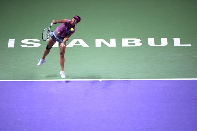 Li Na of China returns a shot to Petra Kvitova of the Czech Republic during their semifinal tennis match at the WTA Championship in Istanbul, Turkey, Saturday, Oct. 26, 2013. The world's top female tennis players compete in the championships which runs from Oct. 22 until Oct. 27.(AP Photo)