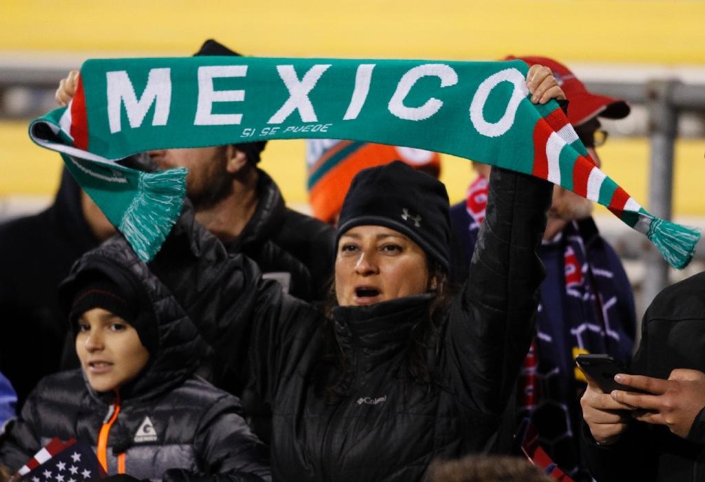 Mexico soccer fans cheer during the second half of a 2018 FIFA World Cup qualifying match between the Mexico men's national team and the US men's national team in Columbus, Ohio on November 11, 2016 (AFP Photo/Paul Vernon)