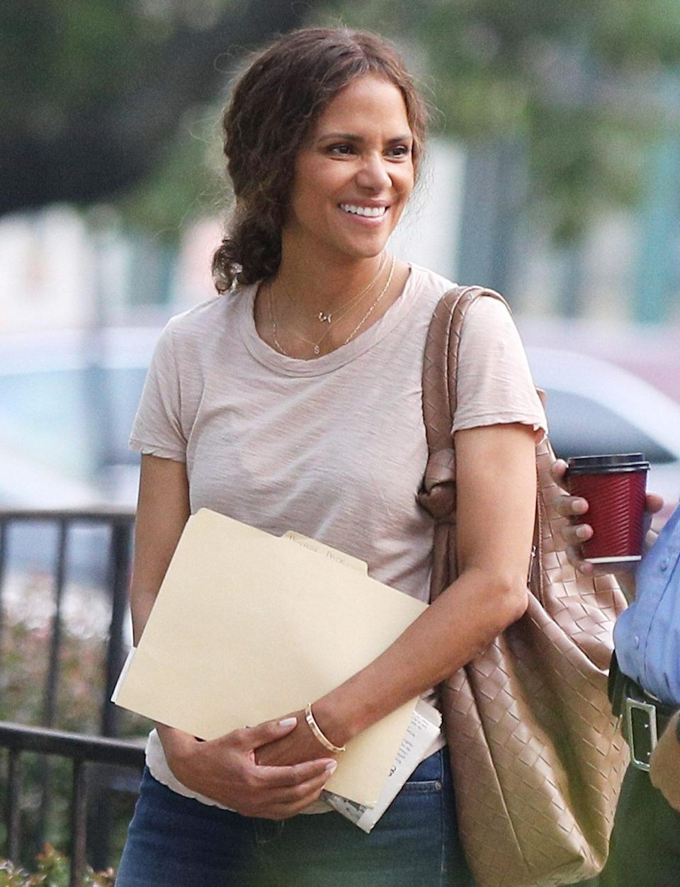 <p>Halle Berry is seen on the set of <em>The Mothership</em> before filming with fellow actor John Ortiz on July 20 in Norwood, Massachusetts.</p>