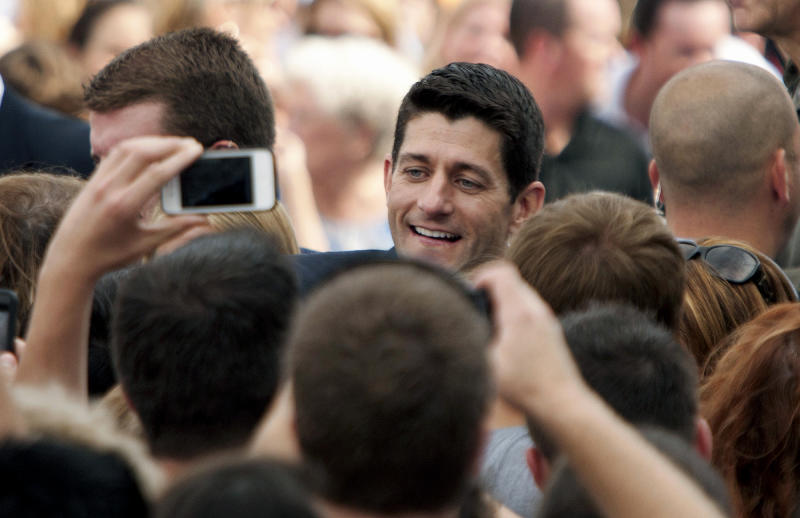 Rep. Paul Ryan, R-Wis., newly announced Republican vice presidential candidate, greets the crowd at Nauticus in Norfolk, Va. on Saturday, Aug. 11, 2012 (AP Photo/Virginian-Pilot, L. Todd Spencer) MAGS OUT