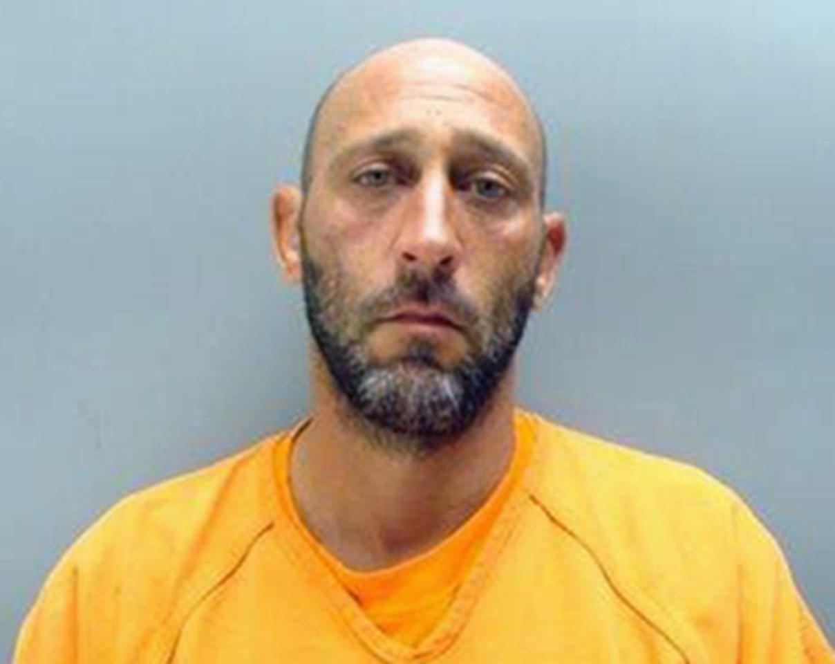 This photo provided by the Case County Jail in Plattsmouth, Neb. shows Matthew J. Stubbendieck, of Weeping Water, Neb., who faces an assisted suicide charge after authorities say he helped his girlfriend, Alicia Wilemon-Sullivan of Orange City, Florida., kill herself in the woods near Weeping Water in early August. Stubbendieck believed his girlfriend had stage-four cancer, but a pathologist who performed an autopsy didn't report any cancerous masses or tumors, according to court records. (Case County (Neb.) Jail via AP)