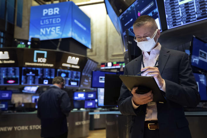 In this photo provided by the New York Stock Exchange, trader Neil Catania works on the trading floor, Tuesday, Dec. 1, 2020. U.S. stocks rose broadly in morning trading Tuesday, sending the S&P 500 toward another record high, as investors focus on the possibility that coronavirus vaccines could soon help usher in a fuller global economic recovery. (Colin Ziemer/New York Stock Exchange via AP)