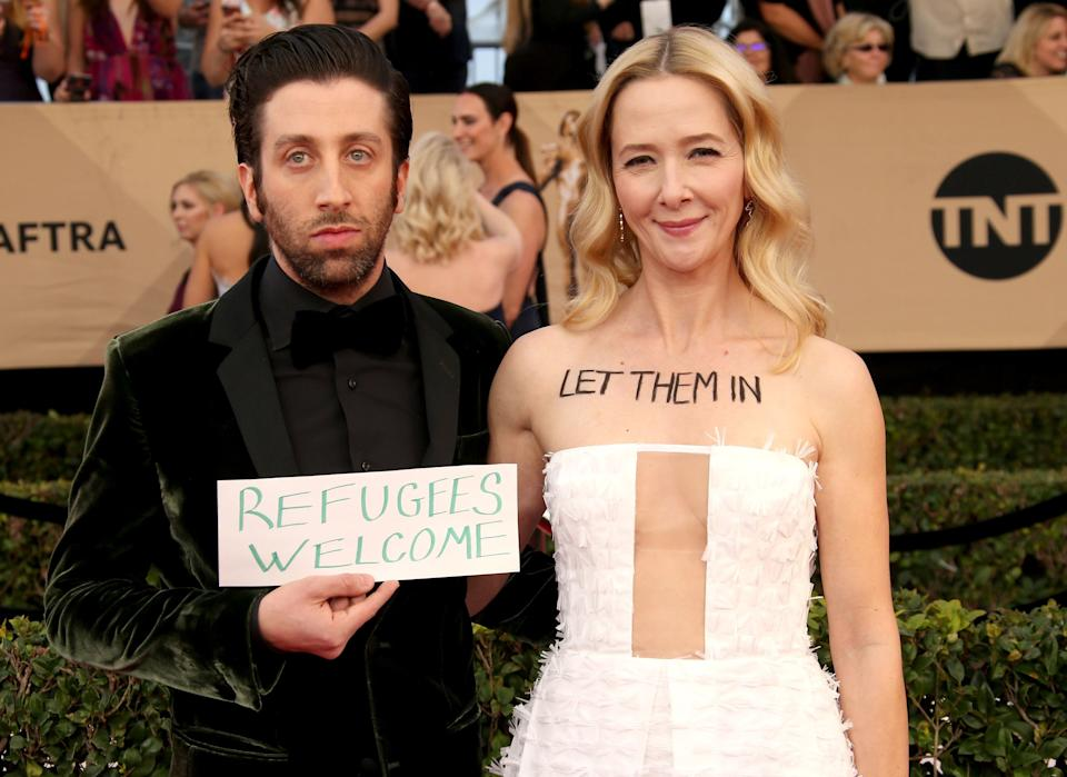 Simon Helberg and Jocelyn Towne brought a sign to the 23rd annual Screen Actors Guild Awards.