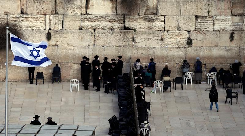Ultra-Orthodox Jewish men (L) and women (R) pray in different sections of the Western Wall in Jerusalem's Old City on February 2, 2016 (AFP Photo/)