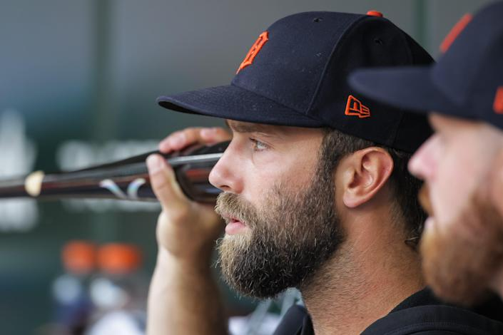Tigers pitcher Daniel Norris holds a bat to his ear before the start of a game against the Twins of the Tigers' 6-5 loss in 10 innings on Monday, July 26, 2021, in Minneapolis.