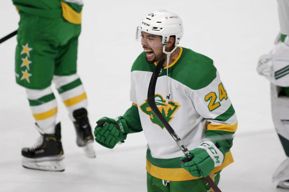 Minnesota Wild defenseman Matt Dumba (24) celebrates his winning goal against the Los Angeles Kings in overtime of an NHL hockey game, Saturday, Feb. 27, 2021, in St. Paul, Minn. (AP Photo/Andy Clayton-King)