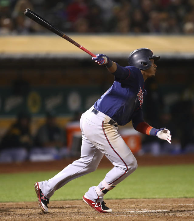 Minnesota Twins' Jorge Polanco watches his three-run double against the Oakland Athletics during the sixth inning of a baseball game Friday, Sept. 21, 2018, in Oakland, Calif. (AP Photo/Ben Margot)