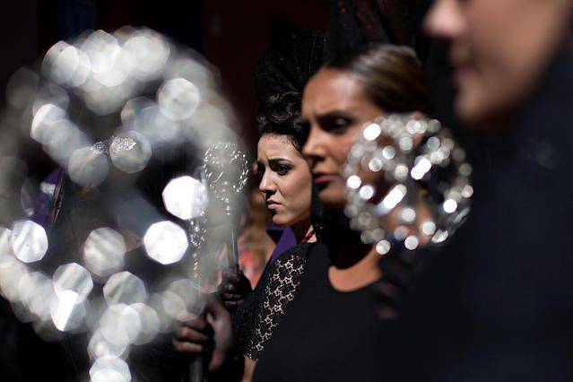 <p>Women wearing a traditional mantilla wait to take part in the procession of los Gitanos brotherhood during Holy Week on on March 26, 2018 in Malaga, Spain. (Photo: Daniel Perez Garcia-Santos/Getty Images) </p>