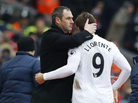 Britain Soccer Football - Liverpool v Swansea City - Premier League - Anfield - 21/1/17 Swansea City's Fernando Llorente is congratulated by manager Paul Clement as he is substituted Reuters / Phil Noble Livepic