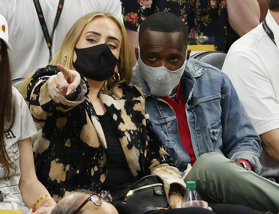 PHOENIX, ARIZONA - JULY 17: Singer Adele looks on next to Rich Paul during the first half in Game Five of the NBA Finals between the Milwaukee Bucks and the Phoenix Suns at Footprint Center on July 17, 2021 in Phoenix, Arizona. NOTE TO USER: User expressly acknowledges and agrees that, by downloading and or using this photograph, User is consenting to the terms and conditions of the Getty Images License Agreement.  (Photo by Christian Petersen/Getty Images)