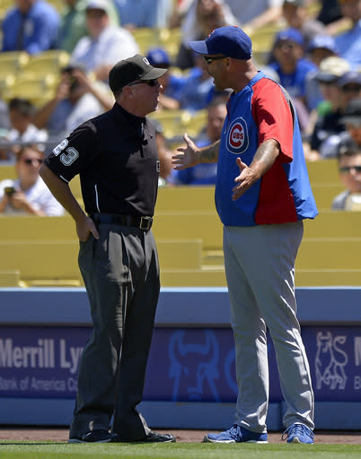 Chicago Cubs manager Dale Sveum, right, argues a call with first base umpire Lance Barksdale during the first inning of their baseball game against the Los Angeles Dodgers, Wednesday, Aug. 28, 2013, in Los Angeles. (AP Photo/Mark J. Terrill)