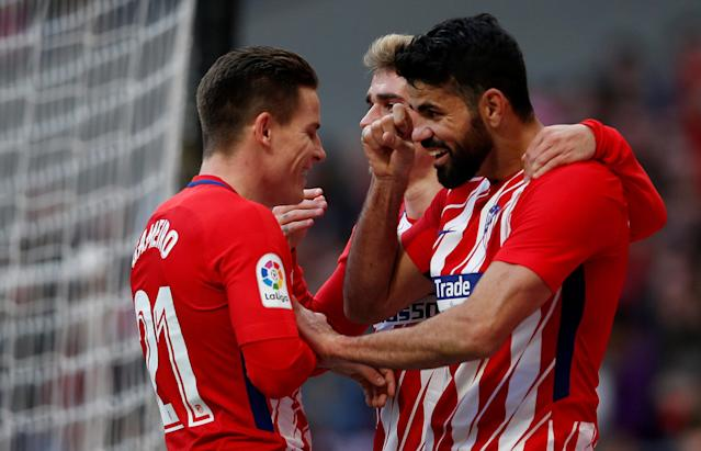 Soccer Football - La Liga Santander - Atletico Madrid vs Athletic Bilbao - Wanda Metropolitano, Madrid, Spain - February 18, 2018 Atletico Madrid's Diego Costa celebrates scoring their second goal with Antoine Griezmann and Kevin Gameiro REUTERS/Javier Barbancho