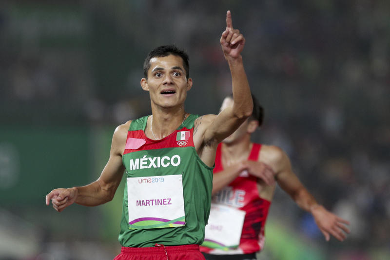 Fernando Martinez ofMexico celebrates winning the gold medal in the men's 5000m during the athletics final at the Pan American Games in Lima, Peru, Tuesday, Aug. 6, 2019. (AP Photo/Martin Mejia)