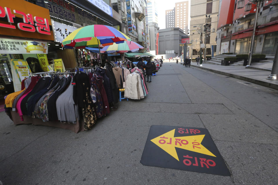 FILE - In this Dec. 7, 2020, file photo, an outdoor shopping street remains vacant amid fears of the coronavirus in Seoul, South Korea. South Korea had seemed to be winning the fight against the coronavirus: Quickly ramping up its testing, contact-tracing and quarantine efforts paid off when it weathered an early outbreak without the economic pain of a lockdown. But a deadly resurgence has reached new heights during Christmas week, prompting soul-searching on how the nation sleepwalked into a crisis. (AP Photo/Ahn Young-joon, File)