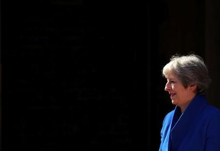 Britain's Prime Minister Theresa May waits to greet heads of state as they arrive for a working session at the Commonwealth Heads of Government Meeting in London, April 19, 2018. REUTERS/Hannah McKay