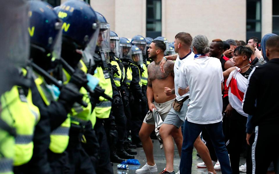 England fans and police outside Wembley. - REUTERS