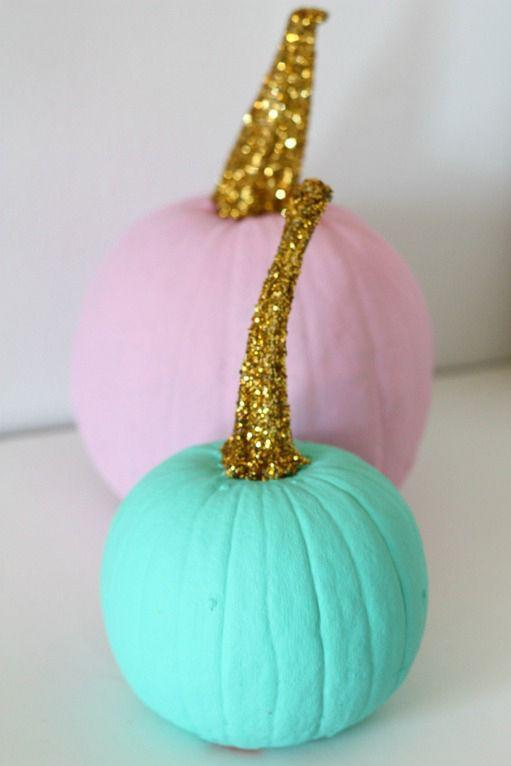 """<p>Regardless of which color you choose to paint your pumpkin's body, a glitter stem gives it an instant upgrade.</p><p><em><a href=""""http://www.nestofposies-blog.com/2013/10/watercolor-pumpkins/"""" rel=""""nofollow noopener"""" target=""""_blank"""" data-ylk=""""slk:Get the tutorial at Nest of Posies »"""" class=""""link rapid-noclick-resp"""">Get the tutorial at Nest of Posies »</a></em></p>"""