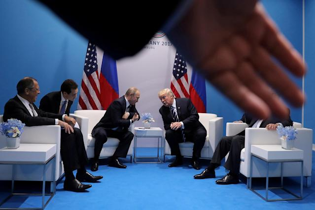<p>Russia's President Vladimir Putin talks to U.S. President Donald Trump during their bilateral meeting at the G20 summit in Hamburg, Germany July 7, 2017. (Photo: Carlos Barria/Reuters) </p>