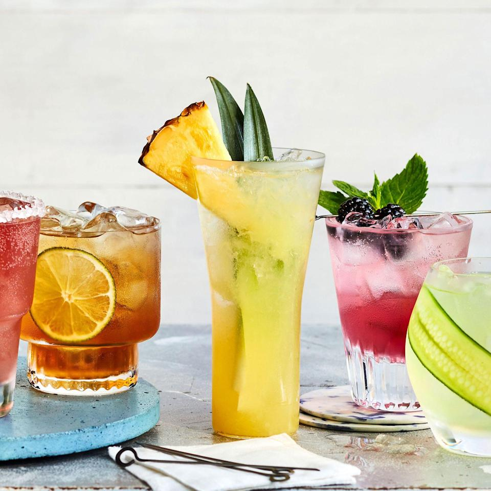 """<p><strong>Recipe: <a href=""""https://www.southernliving.com/recipes/coconut-pineapple-fizz"""" rel=""""nofollow noopener"""" target=""""_blank"""" data-ylk=""""slk:Pineapple-Coconut Fizz"""" class=""""link rapid-noclick-resp"""">Pineapple-Coconut Fizz</a></strong></p> <p>The combination of pineapple, coconut, and rum is enough to give you visions of Jimmy Buffett dancing in your head. However, if you're unable to find coconut-flavored seltzer water, we recommend adding any flavor of Topo Chico and a splash of coconut water or cream of coconut. </p>"""