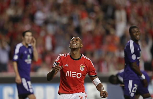 Benfica's Luisao, centre celebrates after scoring against Anderlecht during the Champions League group C soccer match between Benfica and Anderlecht Tuesday, Sept. 17, 2013, at Benfica's Luz stadium in Lisbon. (AP Photo/Armando Franca)