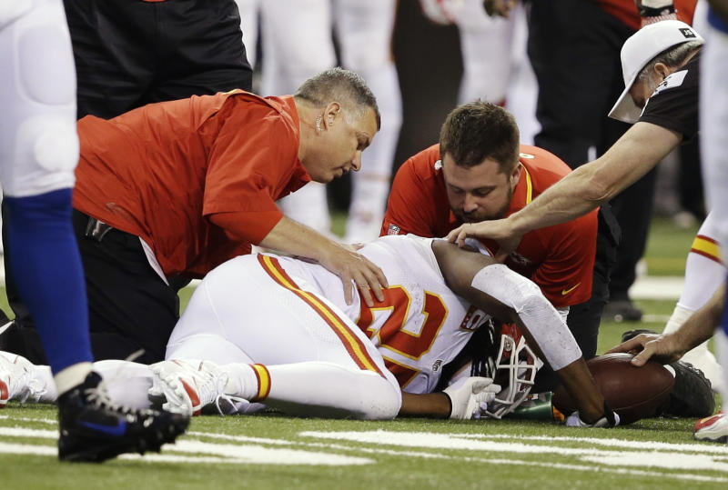 Kansas City Chiefs running back Jamaal Charles (25) is looked at by trainers after going down against the Indianapolis Colts during the first half of an NFL wild-card playoff football game Saturday, Jan. 4, 2014, in Indianapolis. (AP Photo/Darron Cummings)