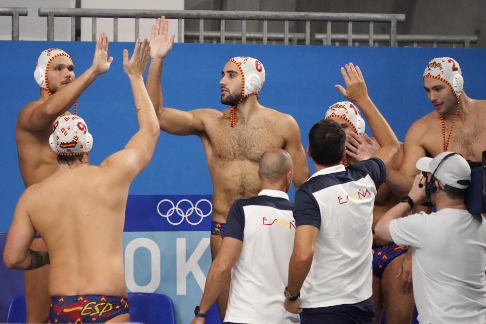 Spain's players and coaches celebrate after a win over Kazakhstan in a preliminary round men's water polo match at the 2020 Summer Olympics, Thursday, July 29, 2021, in Tokyo, Japan. (AP Photo/Mark Humphrey)