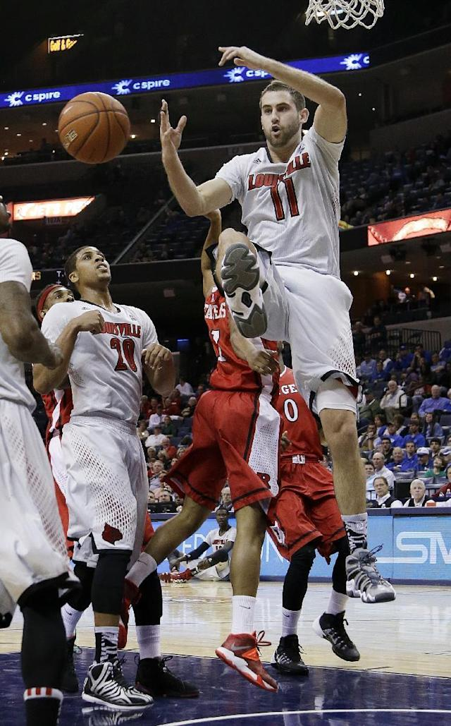 Louisville forward Luke Hancock (11) loses the ball as he drives to the basket during the first half of an NCAA college basketball game against Rutgers in the quarterfinals of the American Athletic Conference tournament Thursday, March 13, 2014, in Memphis, Tenn. (AP Photo/Mark Humphrey)
