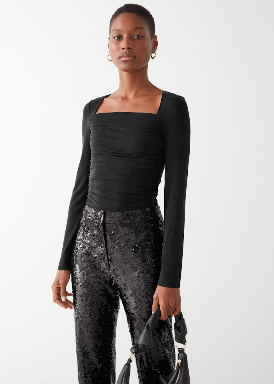 """<p>""""The fabric of this <span>&amp; Other Stories Draped Cupro Top</span> ($59) puts it on the more sophisticated side, but it can easily be dressed down with some light blue wash denim jeans or up when tucked in a slip skirt or textured leather pants."""" - Shelcy Joseph, assistant editor, Shop</p>"""