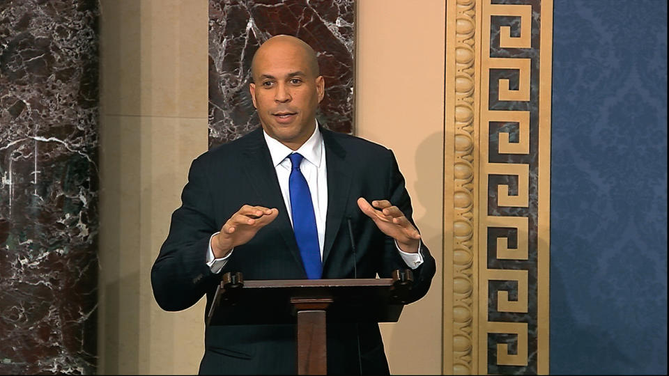 In this image from video, Sen. Cory Booker, D-N.J., speaks on the Senate floor about the impeachment trial against President Donald Trump at the U.S. Capitol in Washington, Tuesday, Feb. 4, 2020. The Senate will vote on the Articles of Impeachment on Wednesday afternoon, Feb. 5. (Senate Television via AP)