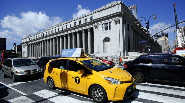 In this Aug. 15, 2016 file photo, a taxi drives past the James A Farley Post Office Building in New York.
